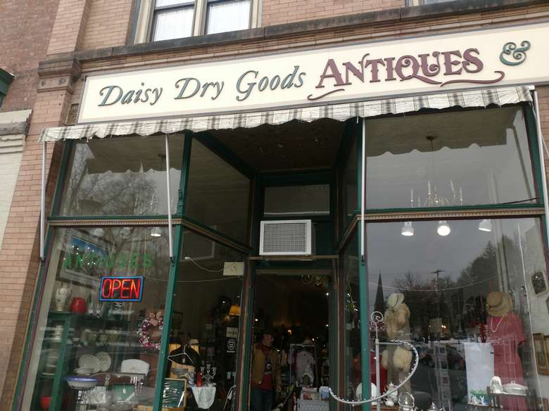 the front entrance of an antiques store
