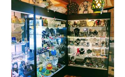 shelves stocked with jewelry and various other items