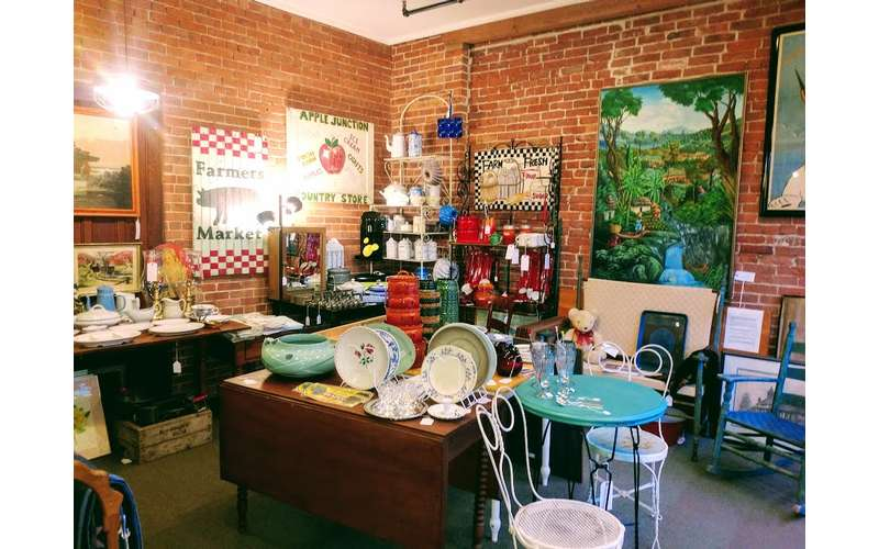 space in shop with artwork, plates, etc. on display