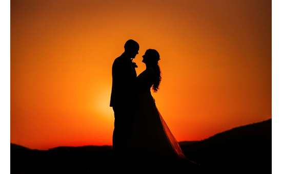sunset and silhouette of man and woman