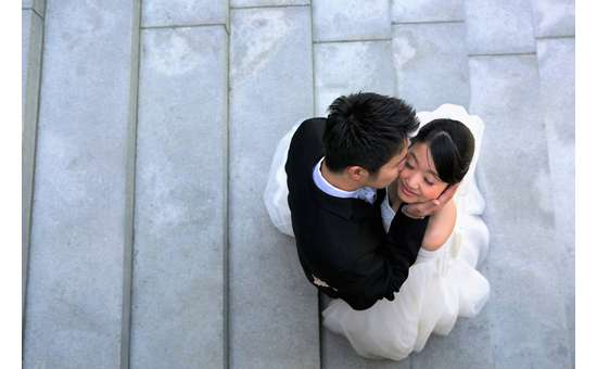 photo from above of a groom kissing the bride