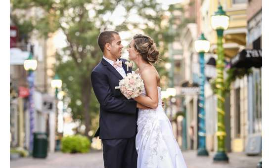 bride and groom embracing in a city area