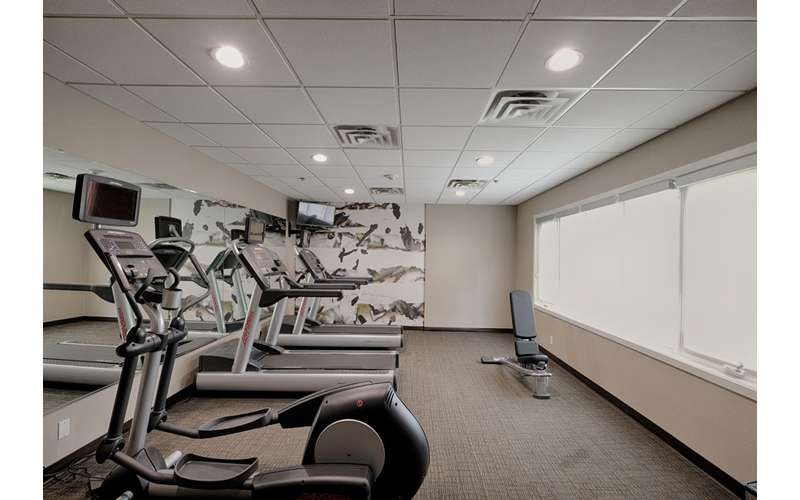 fitness center with four machines
