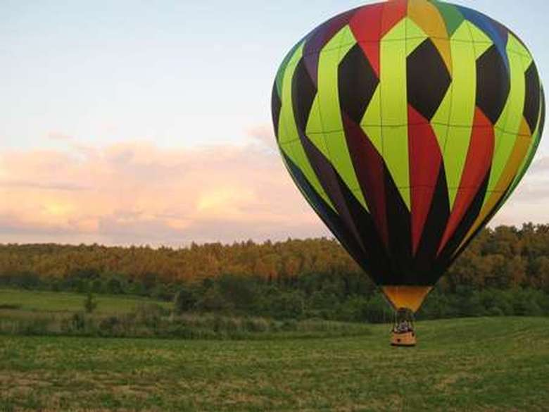 a colorful hot air balloon on a field