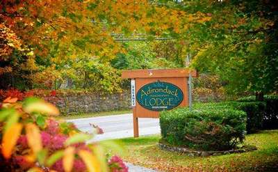 sign among fall foliage saying Adirondack Diamond Point Lodge