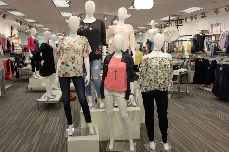 mannequins in a store sporting spring clothes