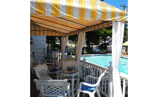 covered porch area at the admiral motel next to the pool