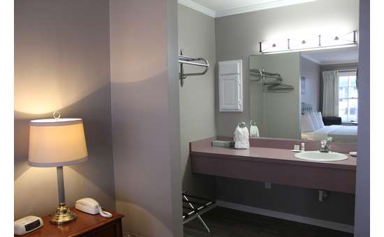 sink area in a king motel room