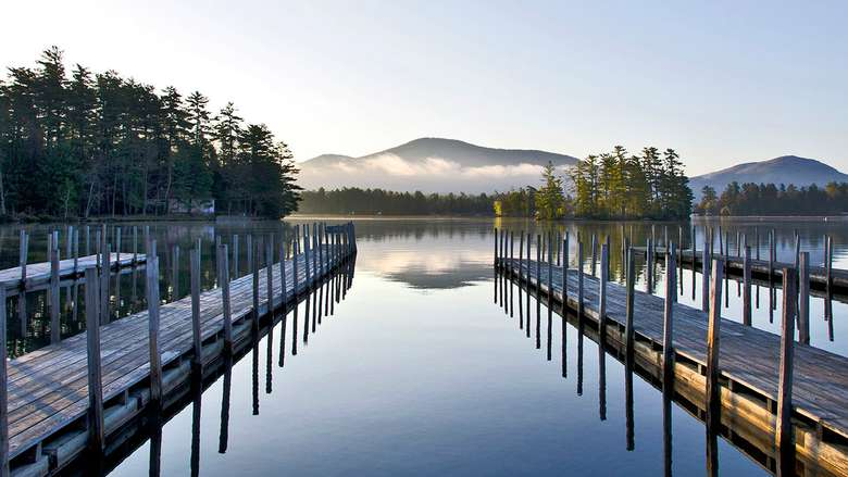 docks on lake george in calm morning waters