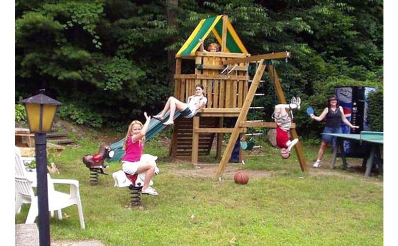 kids playing on a swing set
