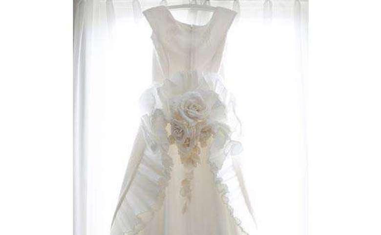 Wedding dress hung up on curtain