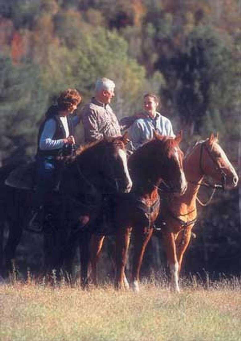 three people on horseback