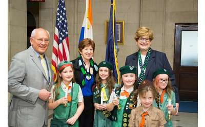 group photo of girls scouts with officials