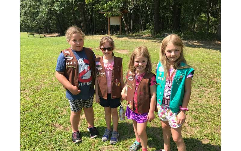 four young girl scouts