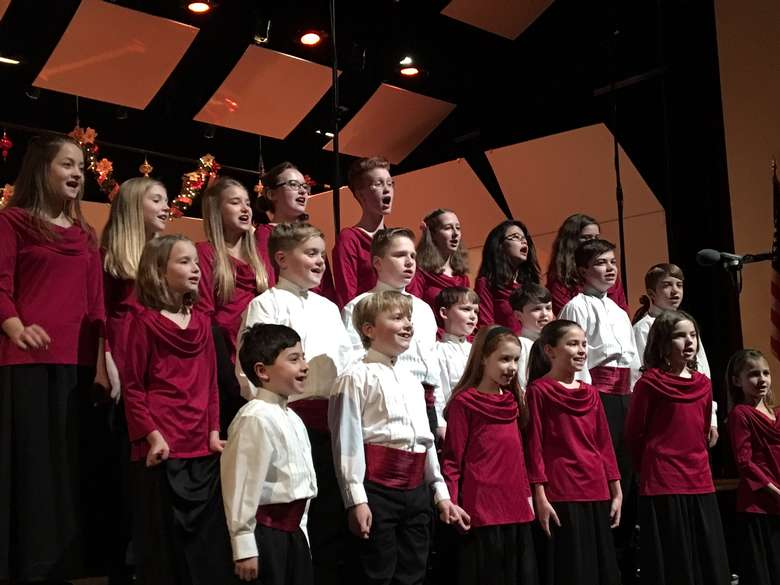 Youth choir singing on risers