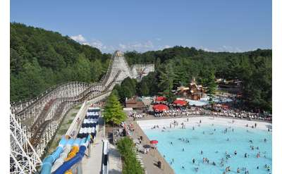 a view of the Comet roller coaster by the wave pool