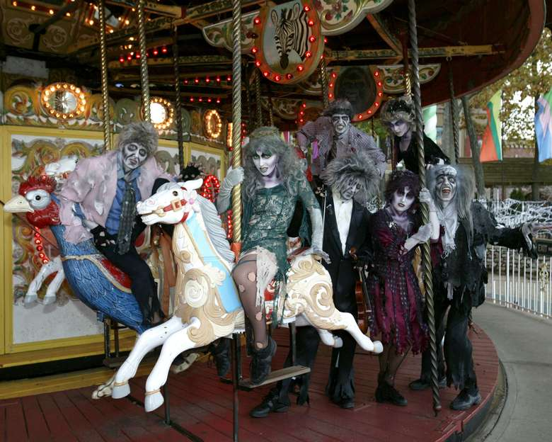 people dressed as zombies on a merry-go-round