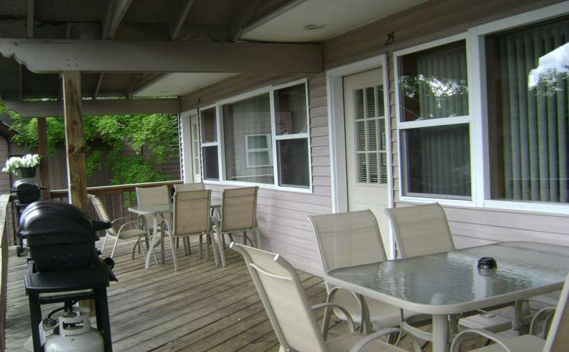 outside deck with tables and chairs set up