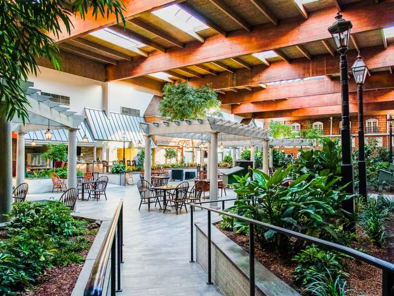 indoor market with skylight windows, plants, and seating