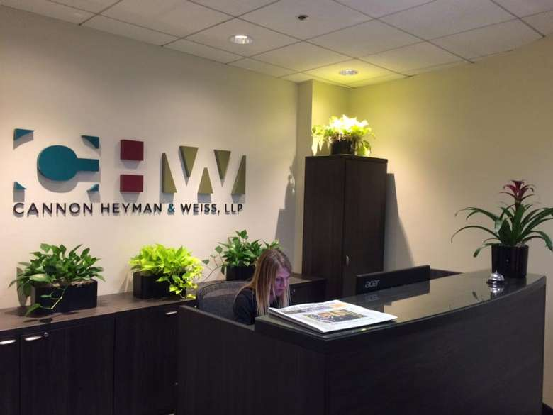 office with a woman that says Cannon, Heyman & Weiss, LLP with plants