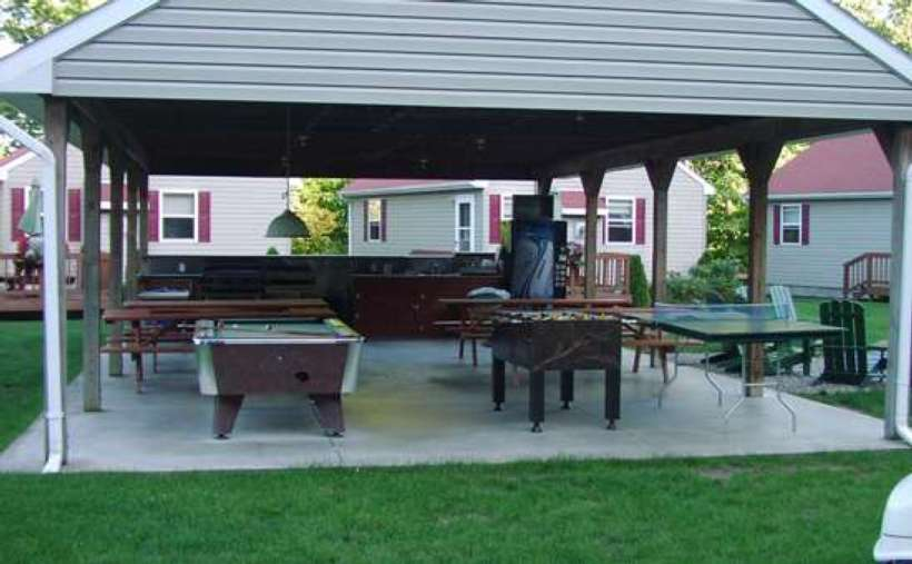 covered outdoor area with picnic tables, pool table, foozeball