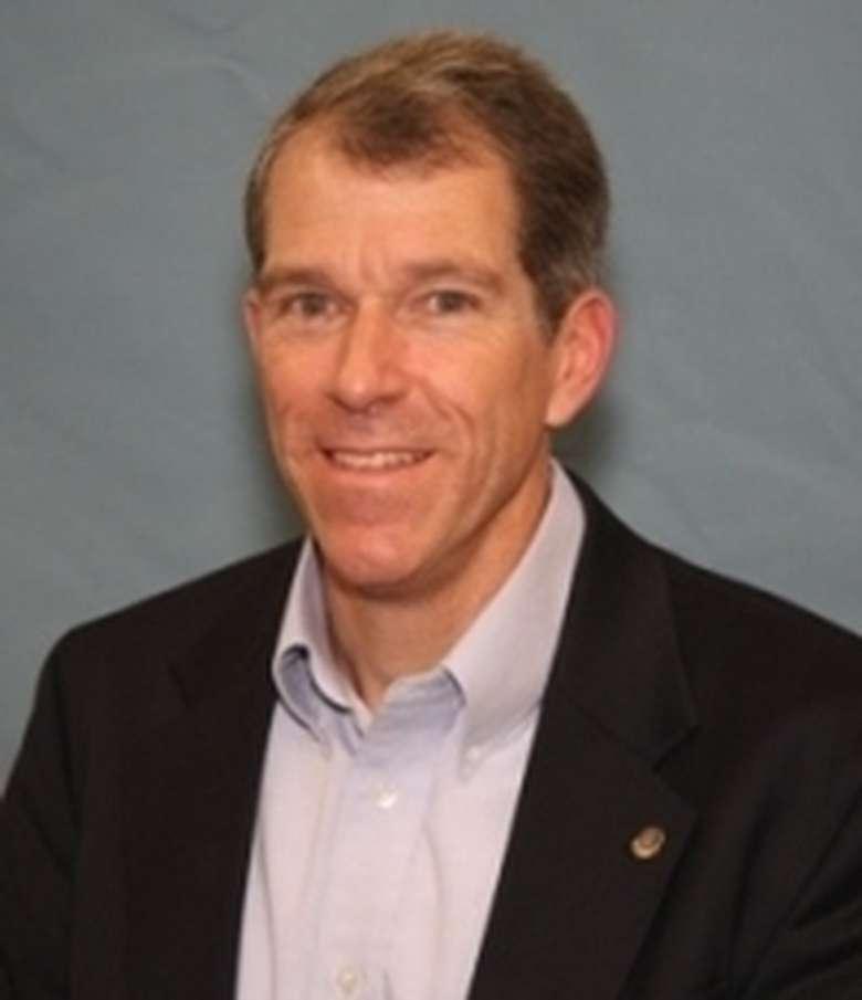 Headshot of James E. Amell