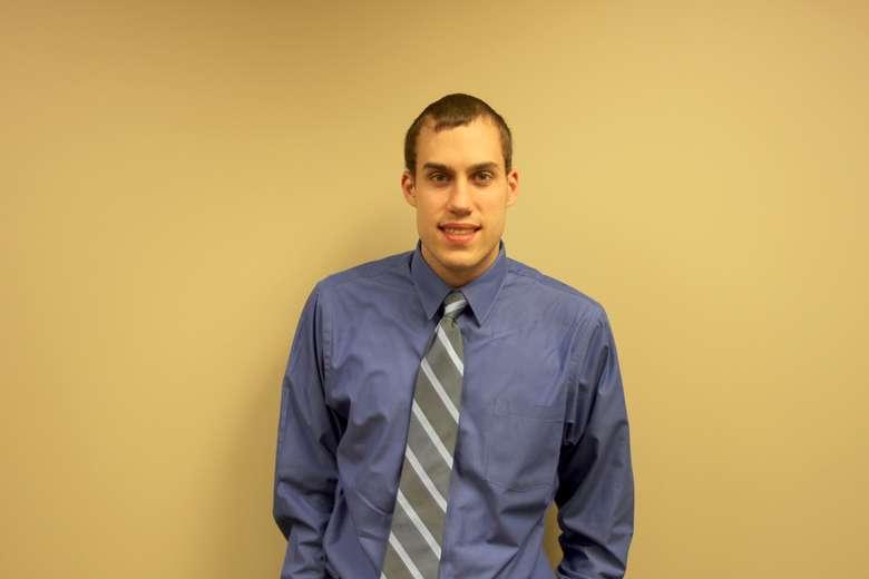 Headshot of Mark J. Quackenbush