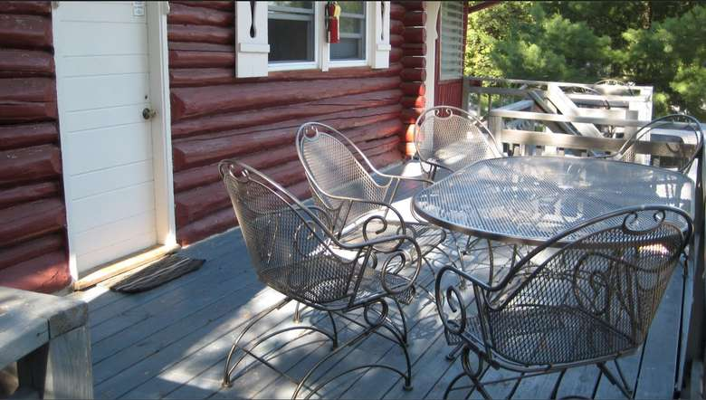 Outdoor dining area with patio table and chairs.