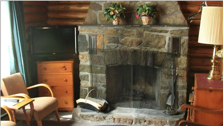 fireplace in cedar log cabin