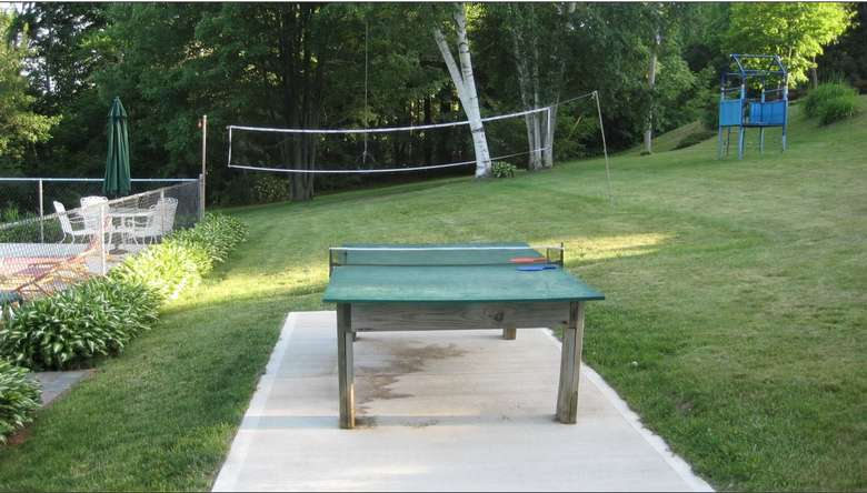 Ping pong table and volleyball net outside of Cramer's Point Motel & Cottages