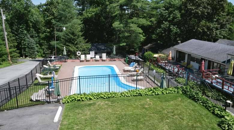 swimming pool by motel lodging.