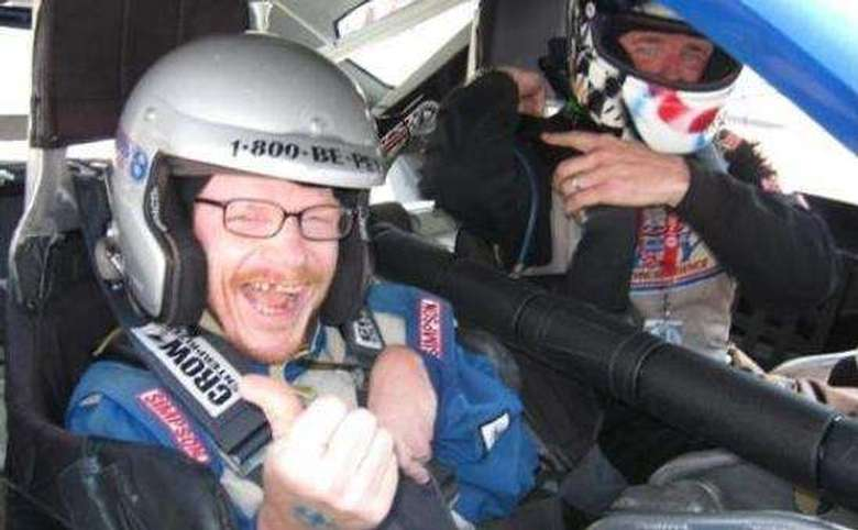 two people in a race car