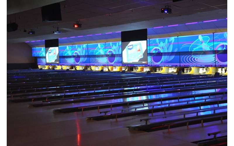 bowling lanes with illuminated images above them