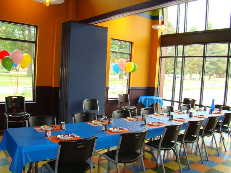 a long table set up for a kid's birthday party