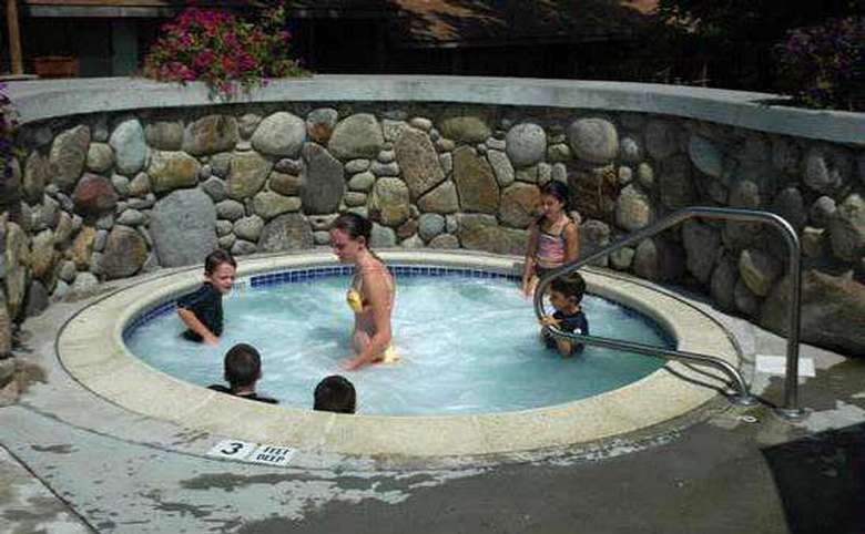 people in an outdoor hot tub