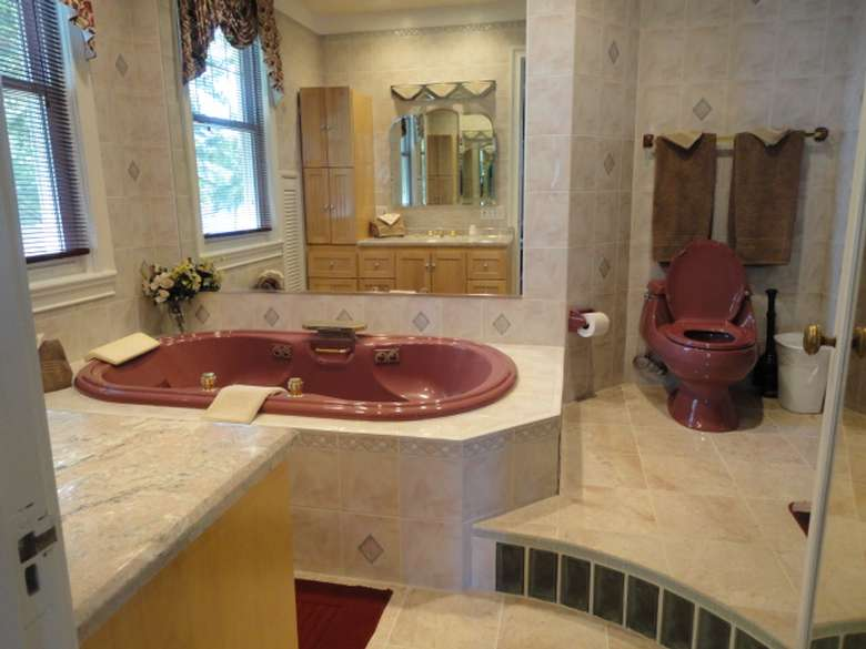 bathroom with a tub with jets