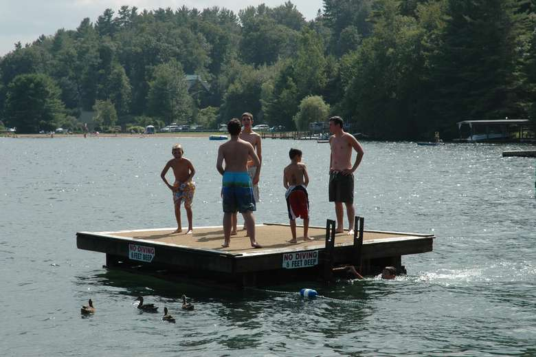people standing on a floating dock