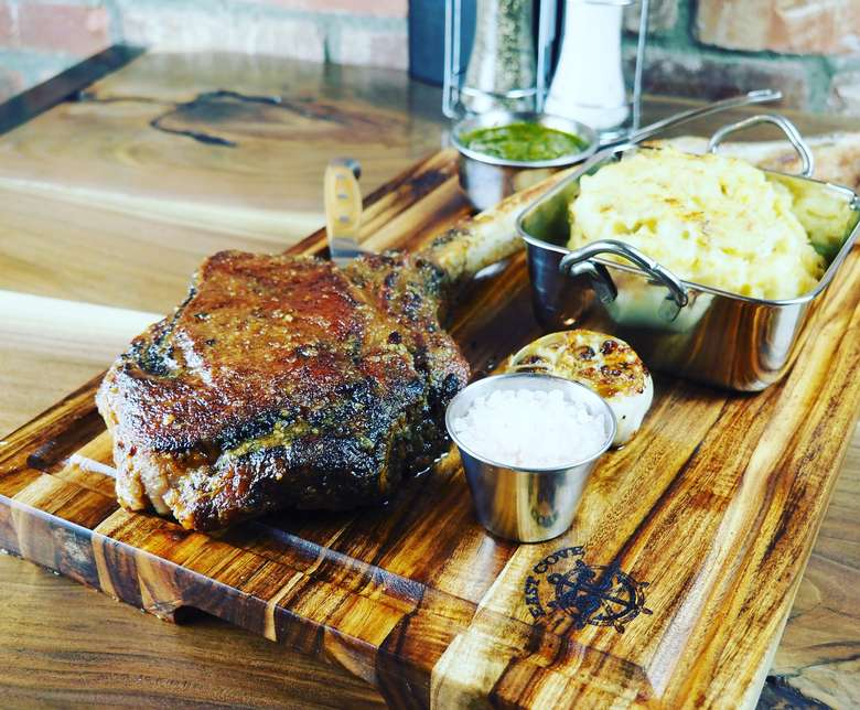 steak and food on cutting board
