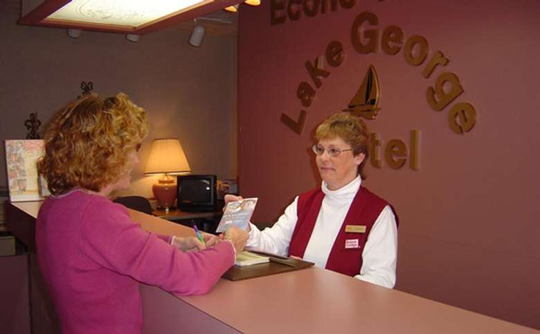 a woman checking in at the front desk