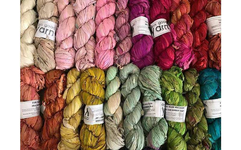 a bunch of different colored yarn