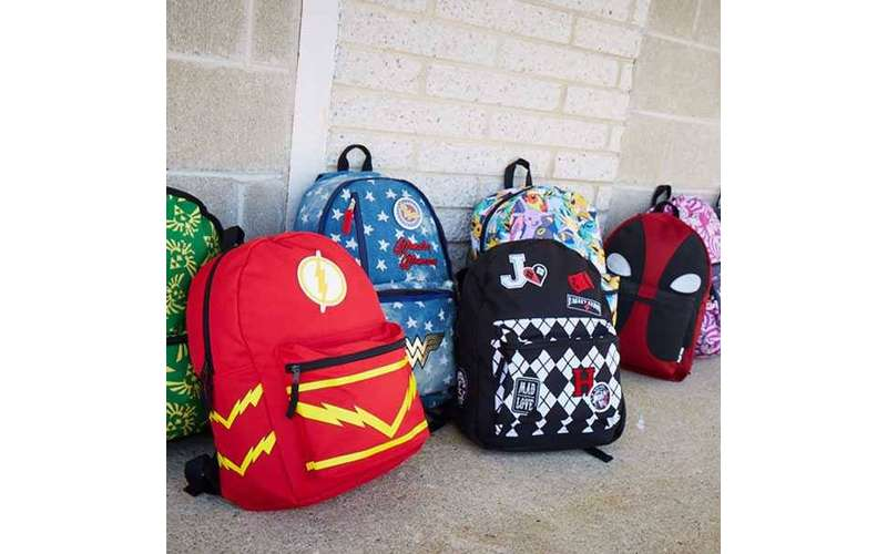a bunch of colorful backpacks