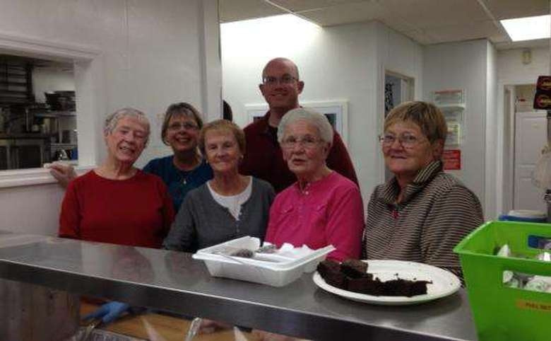 Church members volunteering at kitchen
