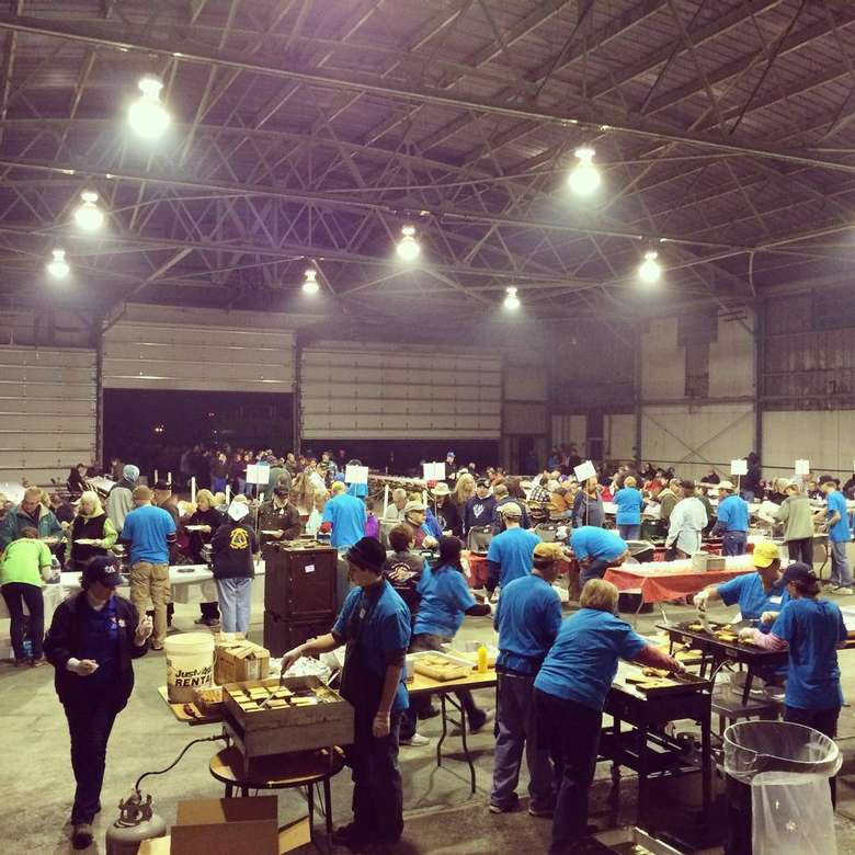 Volunteers in large hanger at Balloon Fest