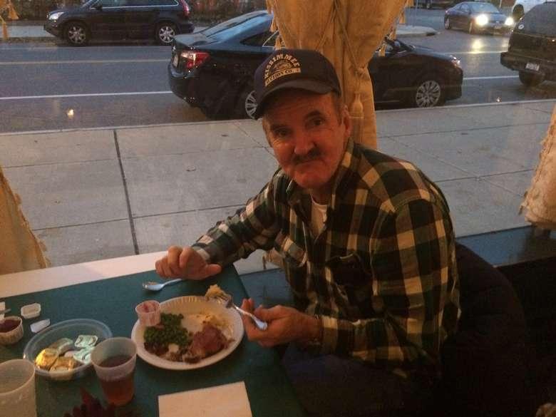 Man eating at a table
