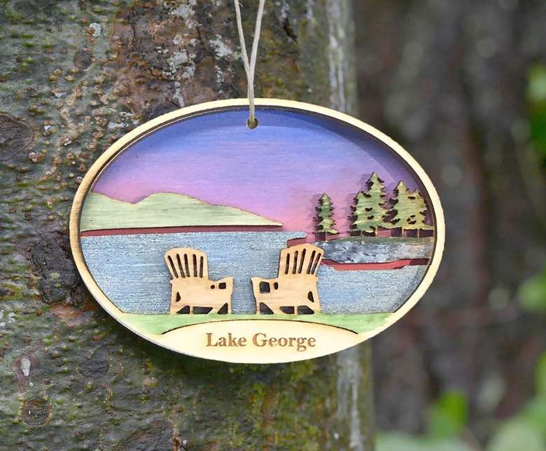 a lake george pendant hanging from a tree