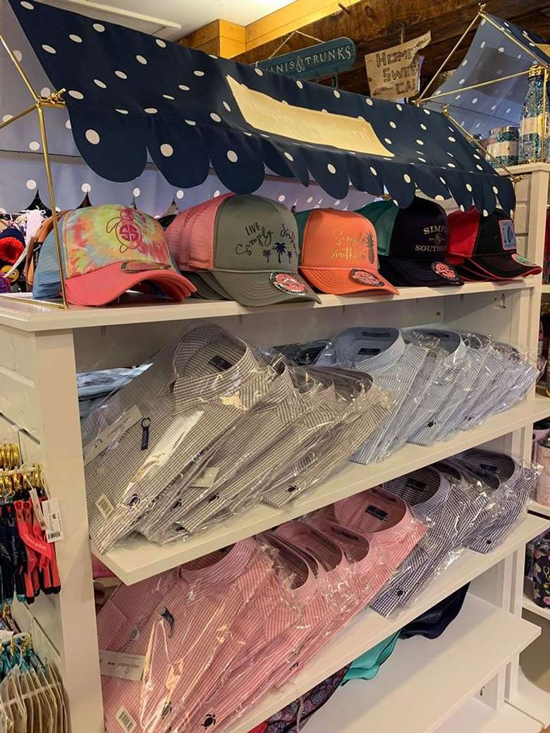 hats and shirts in a store