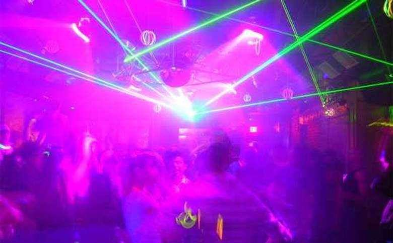 light show above the dance floor at a club