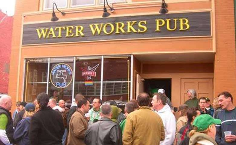 large group of people outside water works pub