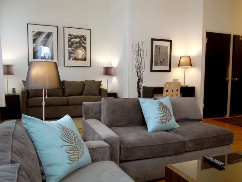 gray sofas in a living room with blue pillows