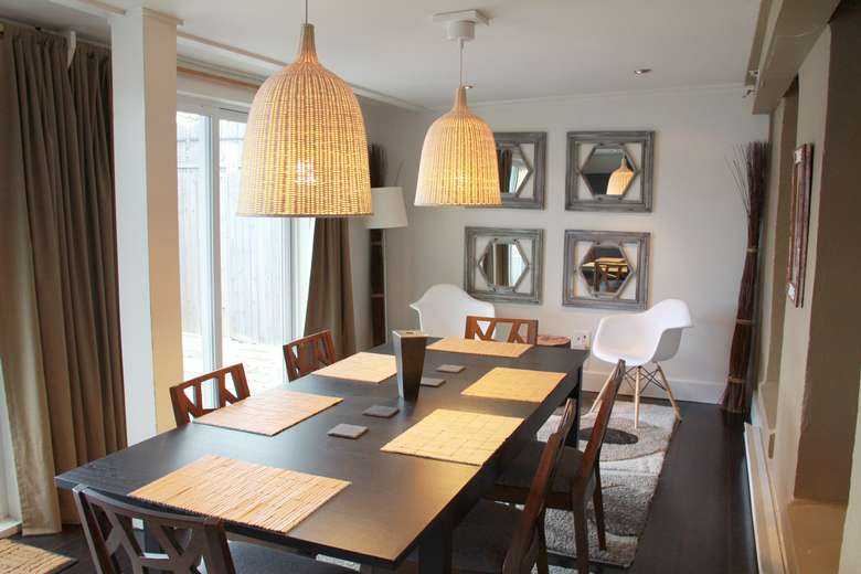 rectangular dining room table in a room
